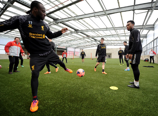 Daniel Sturridge looks askance at Victor Moses at Liverpool training